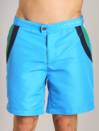 Model in bright blue Hugo Boss Rainbowfish Swim Shorts