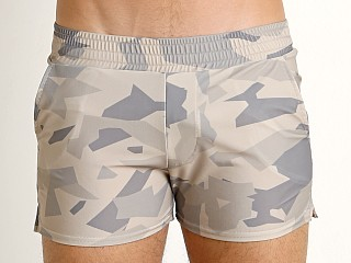 Model in sand Modus Vivendi Desert Camo Swim Short
