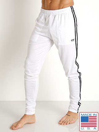 Model in white/black LASC Performance Gymnast Pant White