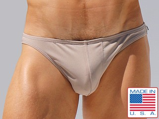 Model in tan Rufskin Kader Stretch Microfiber Low Rise Brief
