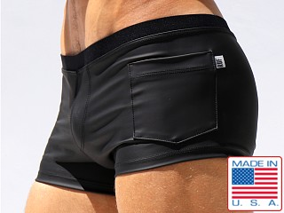 Model in black Rufskin Caliente Rubberized Sport Short