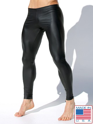 Model in black Rufskin Loki Rubberized Sport Leggings