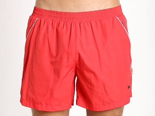 Model in red Hugo Boss Acava Swim Shorts