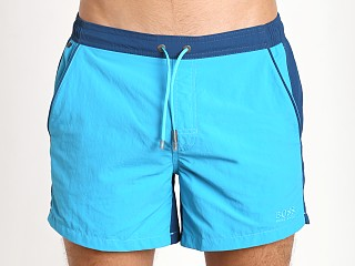 Model in turquoise/blue Hugo Boss Snapper Swim Shorts
