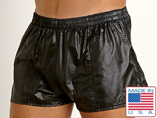 Model in black Rick Majors Ripstop Wet Look Shorts