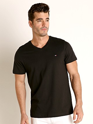 Model in black Tommy Hilfiger Core Flag V-Neck Tee