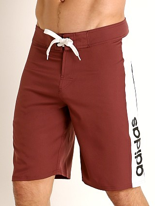 Model in maroon Adidas Stucker II Board Short