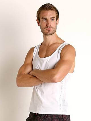 Model in white Nasty Pig Title Intercept Tank Top