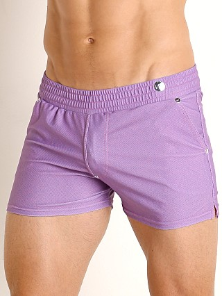 Model in faded fuschia Modus Vivendi Jeans Line Swim/Walk Short