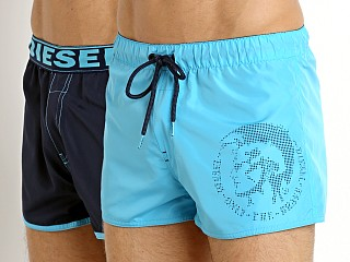 Model in turquoise/navy Diesel Sandy Reversible Swim Shorts