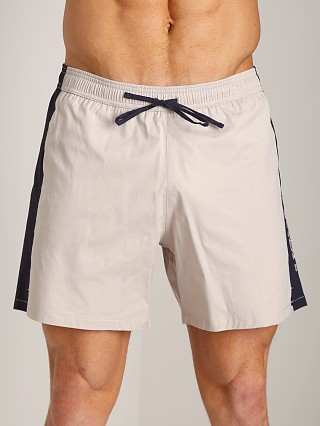 Model in beige/blue/white GrigioPerla Nero Perla Mykonos Colorblock Shorts Beige