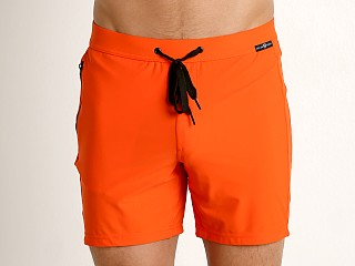 Model in orange Gregg Homme Exotic Swim Shorts