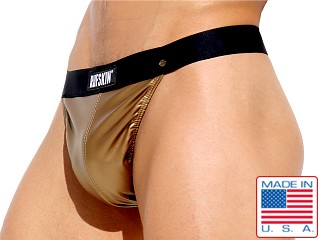 Model in gold Rufskin Gilt Stretch Rubber Thong