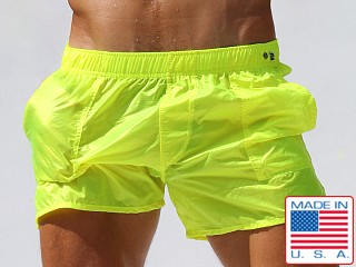 Model in neon lemon Rufskin Nuage Transparent Nylon Pocket Shorts