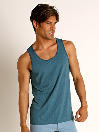 Model in petrol St33le Perforated Mesh Performance Tank Top