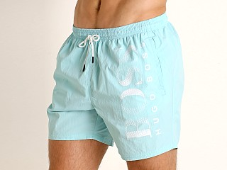 Model in aqua Hugo Boss Octopus Swim Shorts