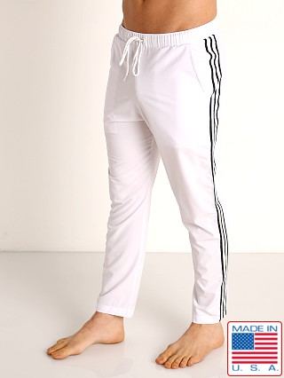 Model in white Sauvage Woven Lycra Athletic Pants