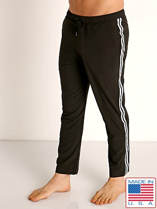 Model in black Sauvage Woven Lycra Athletic Pants