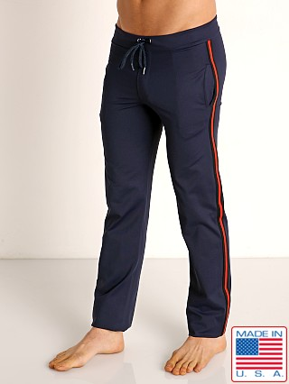 Model in navy Sauvage Tactel Nylon Low Rise Workout Pants