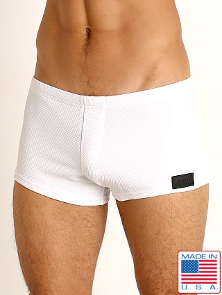 Model in white Sauvage Pique Textured Square Cut Swim Trunk