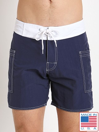 Model in navy/white Sauvage Pocketed Board Shorts