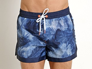 Model in blue leaf print Diesel Sandy Swim Shorts Blue Print