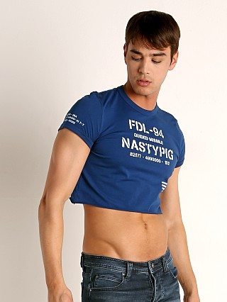 Model in blue Nasty Pig print Crop Top