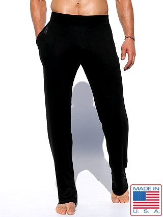 Model in black Rufskin Log Stretch Rayon Lounge Pants