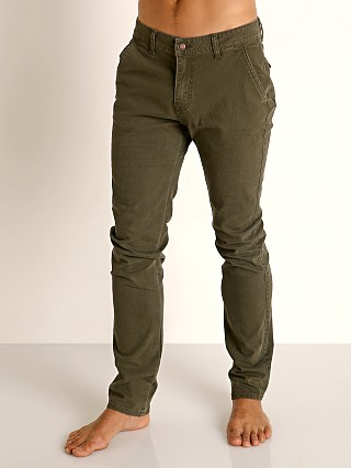 Model in green Cell Block 13 Titan Hidden Zipper Pant