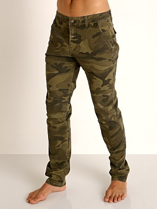 Model in camouflage Cell Block 13 Titan Hidden Zipper Pant