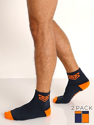 Model in navy/orange Nasty Pig Flasher Socks 2-Pack