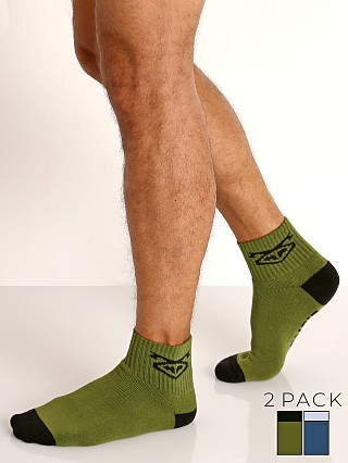 Model in green/blue Nasty Pig Flasher Socks 2-Pack