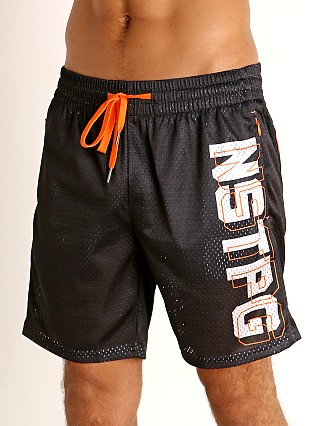 Model in black Nasty Pig Momentum Mesh Short