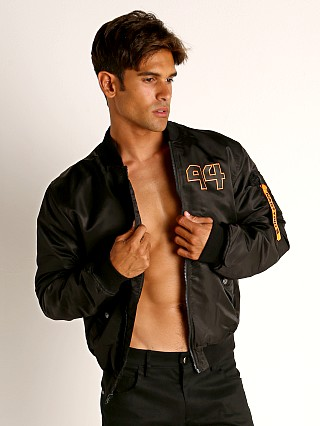 Model in black Nasty Pig Overload Bomber Jacket