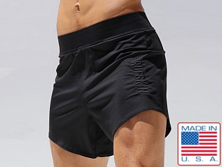 Model in black Rufskin Twelve Perfo-Nylon Workout Short