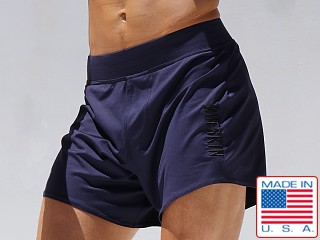 Model in navy Rufskin Twelve Perfo-Nylon Workout Short