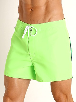 "Model in fluo green #11 Sundek 14"" Classic Low-Rise Boardshort"