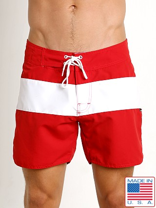 Model in red Sauvage Surf California Classic Boardshort