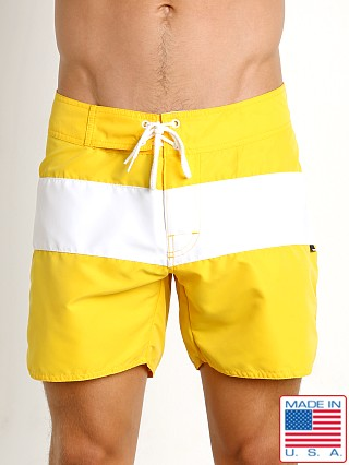 Model in yellow Sauvage Surf California Classic Boardshort