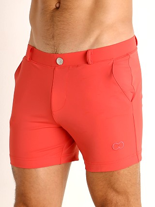 Model in coral 2EROS Bondi Swim Shorts