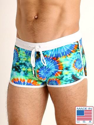 Model in tie dye swirls LASC Square Cut Swim Trunk