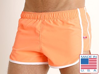 Model in coral Go Softwear Del Mar Swim Shorts