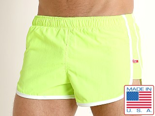 Model in lime Go Softwear Del Mar Swim Shorts