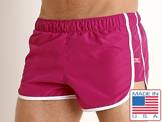 Model in fuchsia Go Softwear Del Mar Swim Shorts