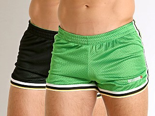 Model in green/black Cell Block 13 Crossover Mesh Reversible Short