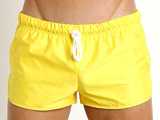 Model in yellow McKillop Drip Bulge-Builder Swim Shorts