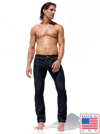 Model in indigo Rufskin Magnum Slim Fit Jeans