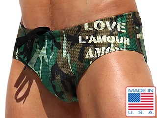 Model in camouflage Rufskin Harvey Summer of Love Swim Brief Camo