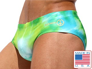 Model in tie dye greens Rufskin Leary Summer of Love Swim Brief