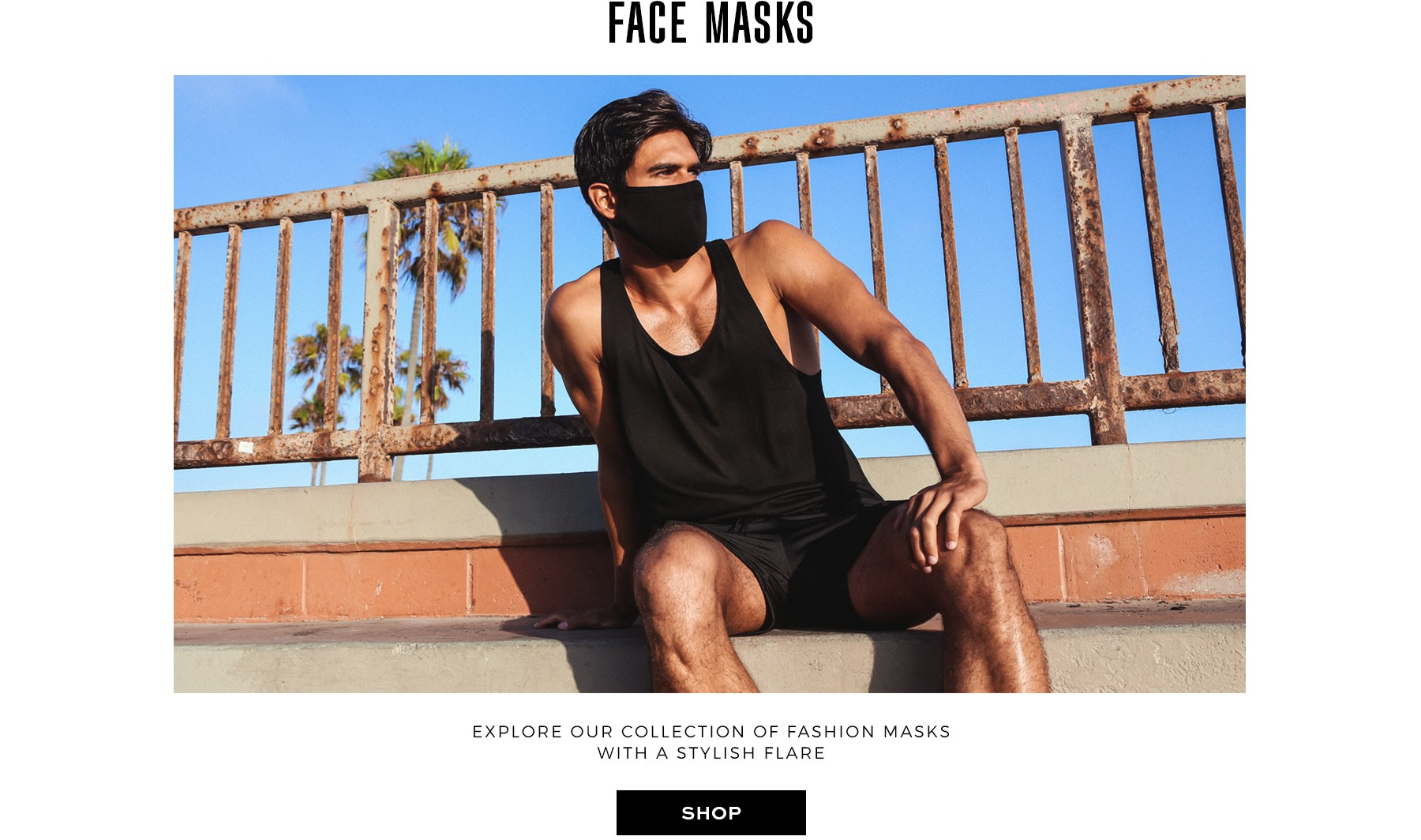 Surfer dude wearing black clothing and face mask